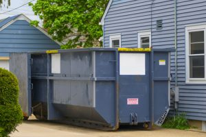 dumpster at the side of family home