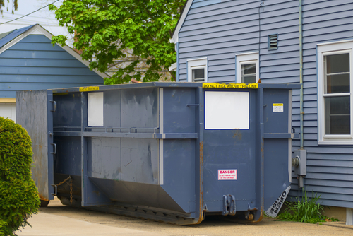 Dumpster Rental on the Side of a House